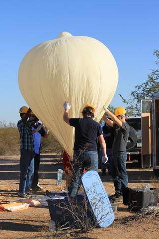 Student teams working on entry-level balloon pay-loads.