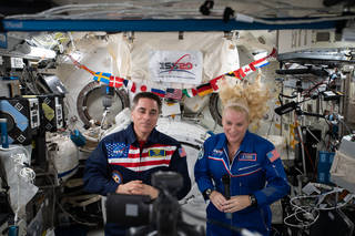 astronauts Chris Cassidy and Kate Rubins during a publicly broadcasted event from ISS