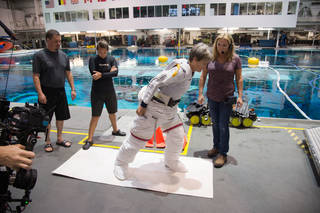 Peggy Whitson prepares for extravehicular activity training at the Neutral Buoyancy Laboratory