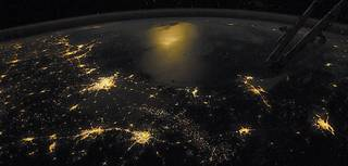 """Earth at Night"" shows how scientists use images such as this astronaut photo of the Gulf of Mexico taken from the ISS"