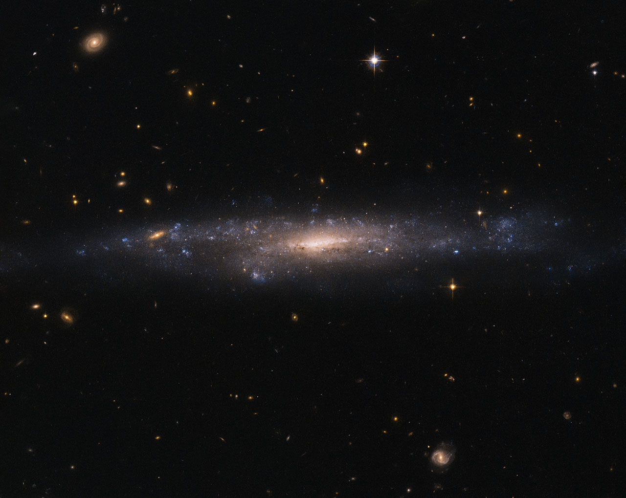 This striking NASA/ESA Hubble Space Telescope image captures the galaxy UGC 477, located just over 110 million light-years away in the constellation of Pisces (The Fish).