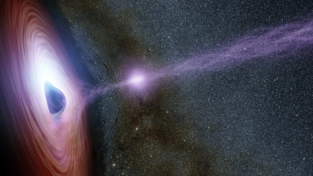 Artist conception: A supermassive black hole is surrounded by a swirling disk of material falling onto it. Credits: NASA/JPL-Caltech