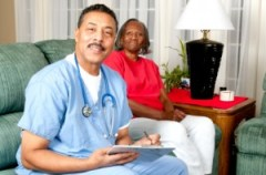 African American Male Home Care Nurse with African American patient in her home