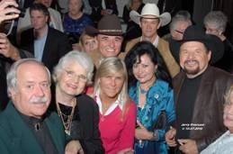 (L-R) Bob Whitaker (Former Grand Ole Opry Mgr.), Jeannie Pruett, Jett Williams, Dixie Harrison and Moe Bandy Behind front row (L-R) Allen Karl and David Church