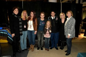 (L-R) John McFee, Crystal Arnold, Aolani Arnold, Hunter Hayes, Kaelynn Arnold, Sergeant First Class Tyler Arnold, Kellie Pickler, and CMA Chief Executive Officer Sarah Trahern Photo Credit: Rick Diamond/Getty Images