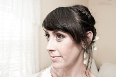 Portrait of a woman with big eyes, dressed and styled for her wedding.