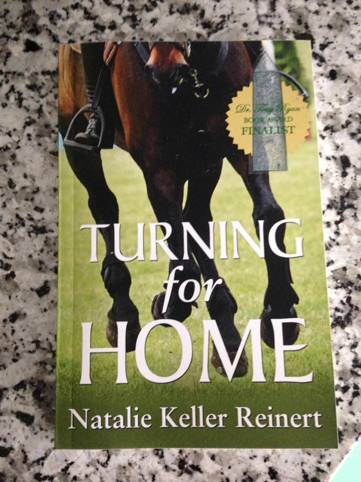 The paperback of Turning For Home - complete with book award sticker!