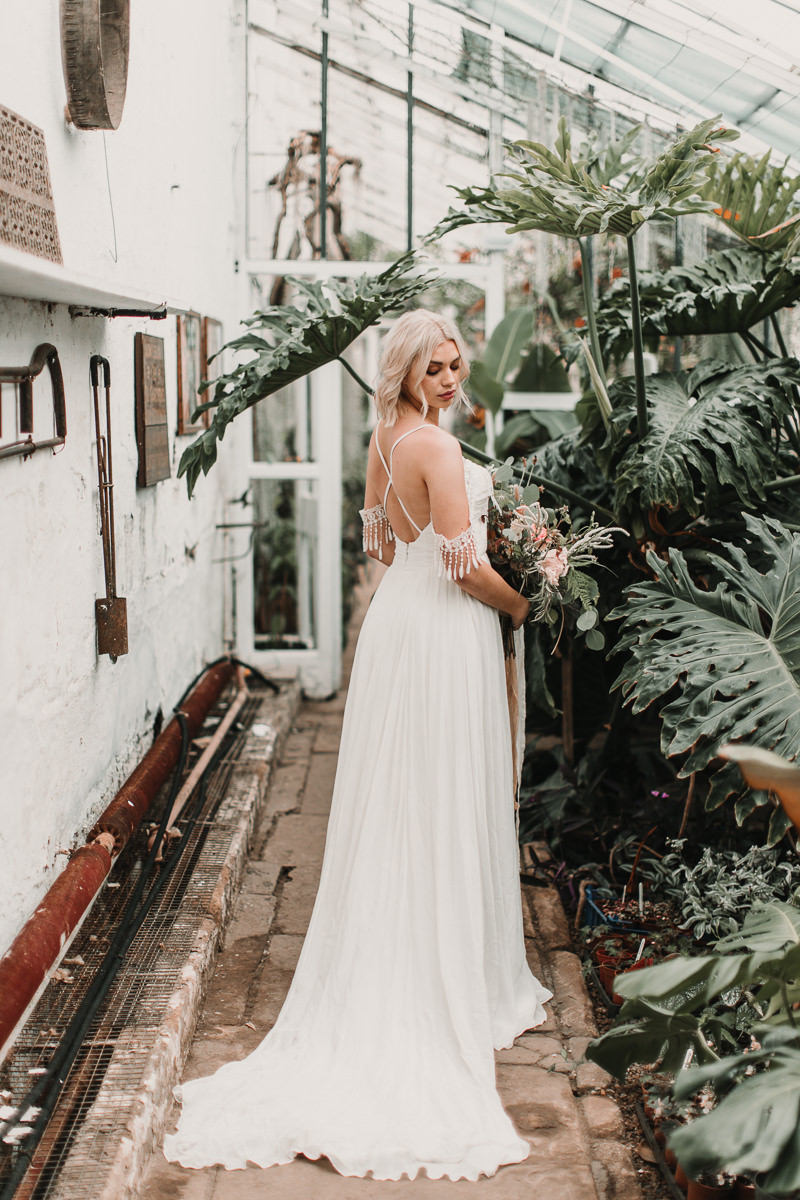 The back and detailing of this boho wedding dress with tassels is just to most heavenly combination. Blush and green Bohemian Wedding Inspiration bringing a little California to you where ever you are in the world. Relaxed styling and desert inspiration and vibes. Wedding ideas for boho brides who an effortlessly relaxed, bohemian wedding. Shot by Natalie Pluck Photography. See full blog post for credits and more inspiration here http://www.nataliepluck.com/bohemian-wedding-inspiration/ 