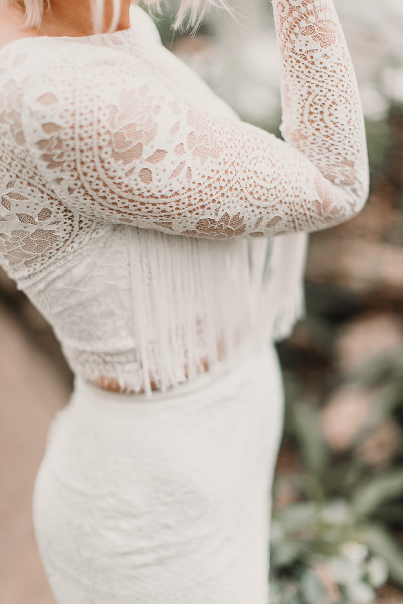 This boho Shikoba Bride wedding dress with tassels is to die for! Blush and green Bohemian Wedding Inspiration bringing a little California to you where ever you are in the world. Relaxed styling and desert inspiration and vibes. Wedding ideas for boho brides who an effortlessly relaxed, bohemian wedding. Shot by Natalie Pluck Photography. See full blog post for credits and more inspiration here http://www.nataliepluck.com/bohemian-wedding-inspiration/ 