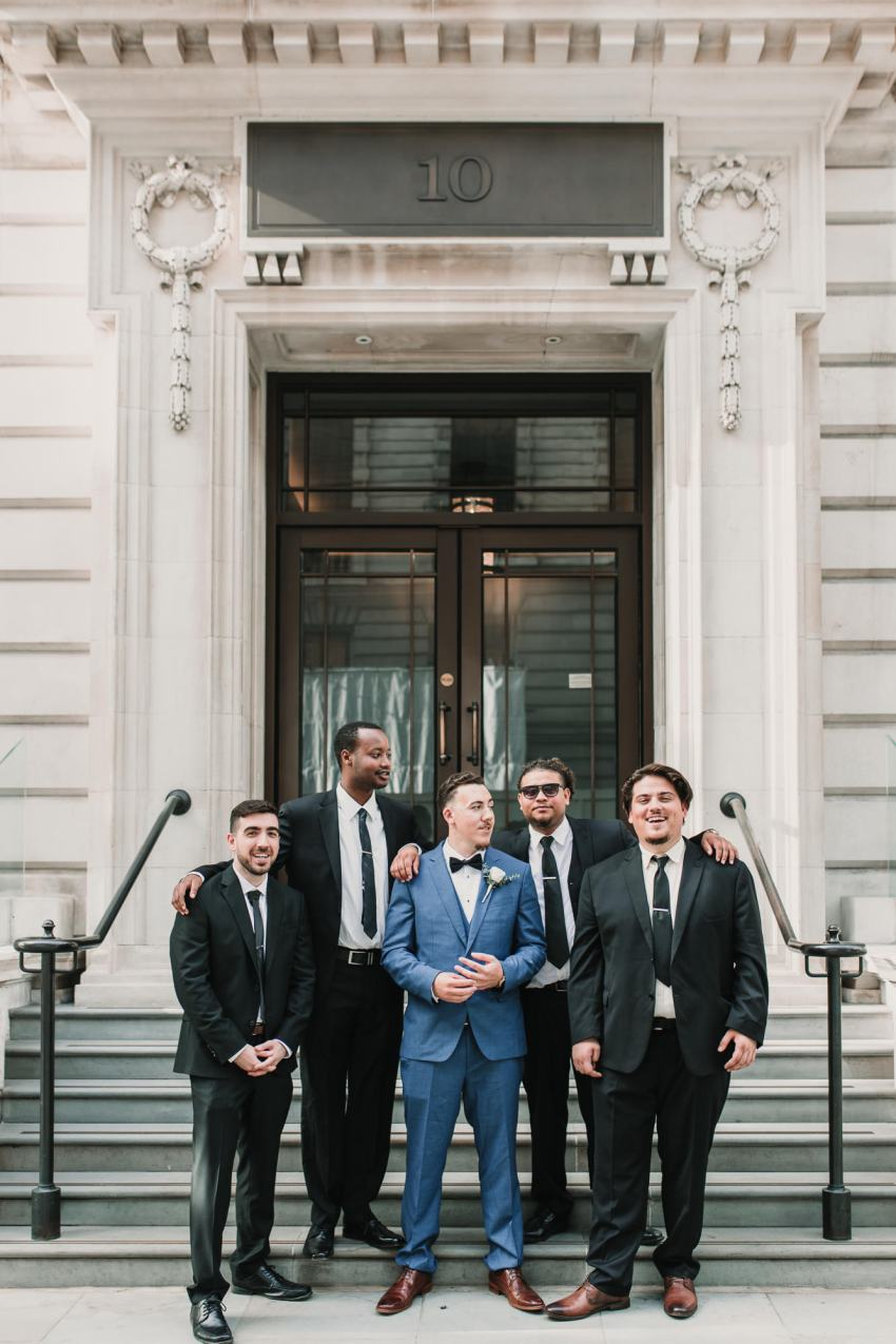 Informal group shot of ushers and best men (groomsmen) for this Elegant London wedding at the Corinthia Hotel, with a stunning Berta dress and golden Jimmy Choo's. Beautiful city portraits in the heart of London. Timeless elegance and relaxed couples portraits. Laid back London Wedding photographer. Photographed by Natalie Pluck. To see more from this wedding click here: http://www.nataliepluck.com/elegant-london-wedding/ #londonwedding #londonweddingphotographer #corinthiawedding #corinthiaweddingphotographer #laidbackelegance #laidbackweddingphotography #canadianportuguesewedding #minimalweddingphotography #minimalistweddings #minimalistweddingphotography #westminsterweddings #westminsterweddingphotography