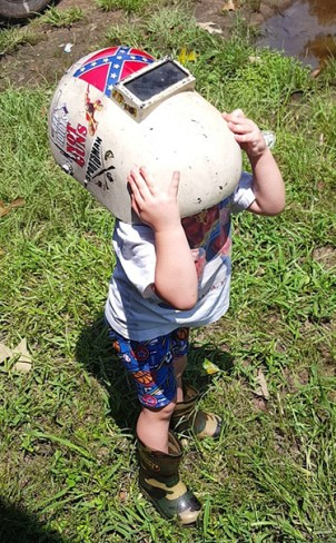 Declan Blanchard, 2, also saw the eclipse though a welding helmet at Black Lake.