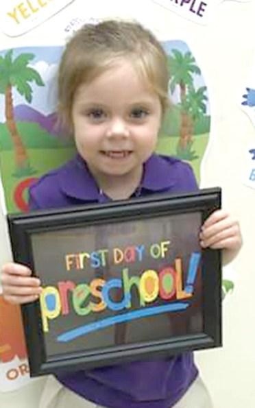 Proudly holding up her sign is 3-year-old Ainsley Jordan, who is up and ready on her very first day of school. Ainsley attends Belmont Union Christian Academy in Belmont and she is the daughter of Leslie Powell and Clayton Jordan.