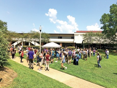 A large crowd of NSU students and faculty gathered at the CAPA fountain to witness the solar eclipse Monday. Professor Michael Yankowski's photography students set up a tent and had several safe viewing options available.