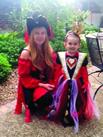 Ella Cole's daughter, Ava Cole, right, was her mother's 'Queen of Hearts' for Halloween.