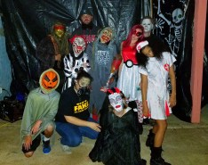 At left, Norman and Earlene Fuller provided their home on Adams Ave. as the location for a community haunted house for over a decade. Over 200 visitors went through the house on Halloween. On front row from left are Tyler Prothro and Emily and Alyssa Halko. On middle row are Jonathan Fuller, Jasmine Howard, Kimberly Osborn and Silvia Vaughn. On back row are Dustin Prothro, Cody Fuller and Chris Winfrey.