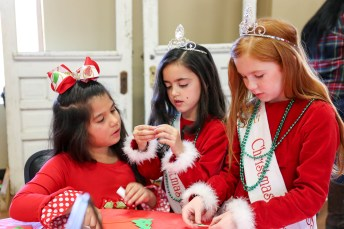 Bella Lopez with Angels Darvy Allison and Presley Trull at a crafts table.