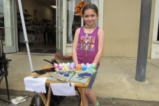 Dessirae Jones, 9, sold her handmade driftwood art on Saturday. She glued pieces of woods, glass and plastic Easter eggs to them.