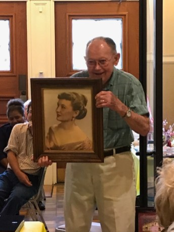 """Bob Porter with a portrait of the """"love of his life,"""" the late Mrs. Shirley Porter."""