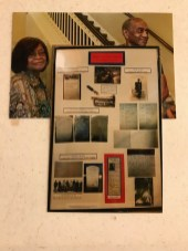 Oneda and Paul Morgan with a display of five generations of the Demery family's military history.