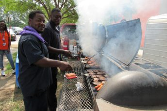 Michael Gillie and Brandon Parker grilled up hamburgers and hot dogs for the public.