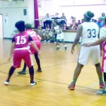 Lady Mustangs-Elan Monet looks to pass to Victoria Robinson