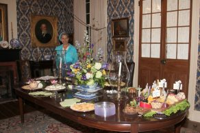 Teresa Rachal stands by the food table