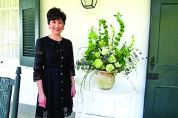 Chrissey Henry included snowball hydrangeas, geranium, thistle, bells of Ireland and snapdragon in her arrangement. It was placed outside next to the front door of the plantation and was this first one guests saw as they signed in.