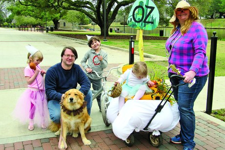 """The first place winner is the Stokes family, with a theme of """"The Wizard of Oz,"""" including Kari, Sam, Patrick, Charlotte and Alison Stokes, with Lava as the Cowardly Lion."""