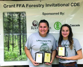 From left are Salem Johnson and Emily Windham with their plaques for placing as overall high individuals.