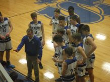 Coach Tom Collins continues to coach up the team with a large lead. By Trent Friedel