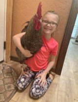 va Martin and her new rooster Rip