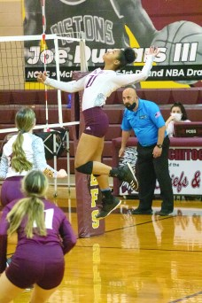 Natchitoches Central Varsity Volleyball player #21, Des Robinson, flies high to attack during a match up Tuesday at home against Ruston. See more on Page 10A