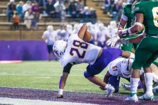 ASH's #28, Jarvis Newton, lands in the end zone. Photo by Chris Reich, University Photographer.