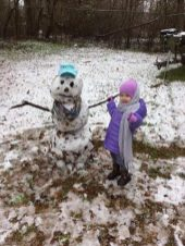 Amelia Smith is all smiles on her first snowman.