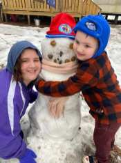Brayden Montoya (Age 4) Daughter Charlee Montoya (Age12) and Olaf the snowman