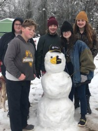 Marthaville students, Caitlin Moak, Gavin Clary, Lanie Clary, Kimee Moak and Melanie Clary with their Hawk.