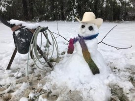 Kelly Withers Yelverton and her cow roping snowman.