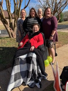 Jennifer Sparks, Katie Lindsey, Mollie Sparks, and their mother, Elaine Sparks, with Lori.