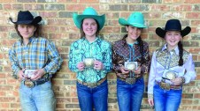 Displaying their regional buckles are, from left, Tatum Roberts, Adrian Nelson, Brooklyn Johnson and Hayden Sellers.
