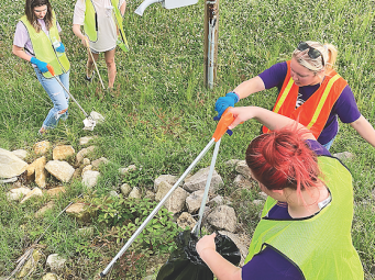 Volunteers split up to cover ground and picked up debris to beautify the city streets.