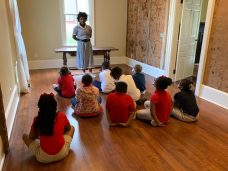 Chloe Kelly, eighth grader at Magnet School, tells students the history of renown folk artist Clementine Hunter from Hunter's perspective at the Prudhomme-Rouquier House.