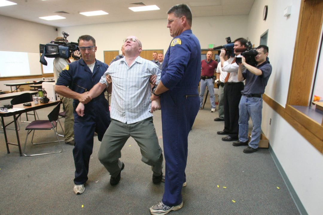 Nathan Isaacs getting tasered as newspaper reporter