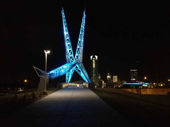 On Friday night, I convinced a friend to go exploring in downtown OKC with me. There were a few places I wanted pictures before leaving the state late next month. This is one of my favorite pictures.  The SkyDance Bridge over I-40 towers in the foreground, while the Devon Tower holds the background with all its strength. These are two major Oklahoma City icons.