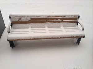 A Pearl bench, perfectly covered in snow.
