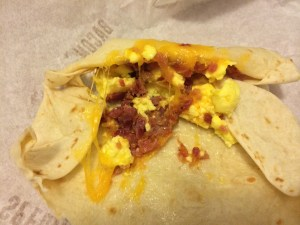The breakfast burrito with bacon, opened.