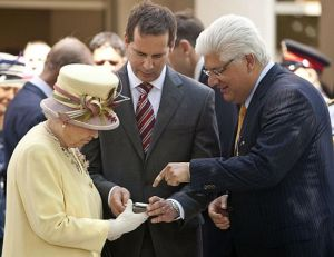 The Queen checks out a blackberry