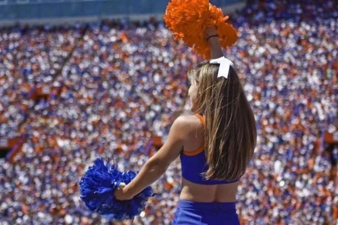 Cheerleader in front of crowd