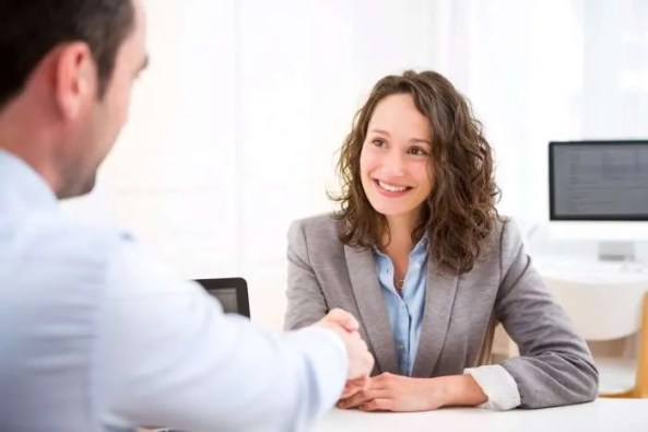 woman on job interview shaking hands