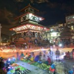 People shop and hang out at a night market in central Kathmandu, Nepal, May 2014. (Dibrova/Shutterstock)