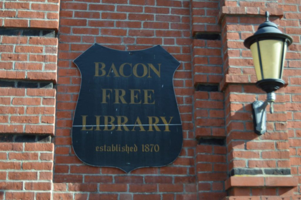 bacon free library south natick sign